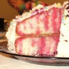 Poke Cake II - This is a white cake, that you poke holes in and pour warm fruit flavored gelatin over it and chill. It has a whipped topping frosting.