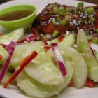 Asian Cucumber Salad - Sliced cucumbers and red chile peppers are tossed with a rice vinegar and sesame oil dressing.