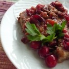Simmered Cranberry Pork Chops - Pork chops are browned and then left to simmer in a sweet cranberry sauce.