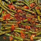 Daphne's Green Beans - Fresh green beans, onion, and canned tomatoes are spiced up with chipotle peppers in adobo sauce for this terrific vegetable side dish.