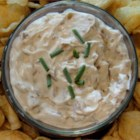 French Onion Dip From Scratch - This creamy and rich dip is a hit at any party. Fresh onions cook down to give this dip the sweetest flavor, far superior to any powdered soup mix French onion dip.