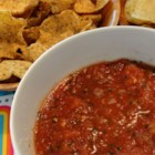 Easy Blender Salsa - Made in a flash by using the blender, this zesty salsa is seasoned with jalapeno pepper, onion, cilantro, and lemon juice. Adjust the amounts to suit your taste.