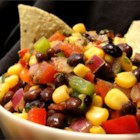Heather's Cilantro, Black Bean, and Corn Salsa - This lively summer recipe can be served with tortilla chips as an appetizer, or with chicken or fish as a fresh and flavorful side dish. Made with corn, black beans, tomato, onion, pepper, and avocado, this salsa has the most amazing balance of textures in a great presentation.