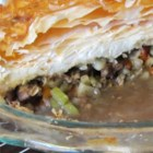 Beef Pot Pie I - This version of a traditional family favorite calls for beef tenderloin, and includes porcini mushrooms, carrots, celery, and potatoes. Packaged puff pastry makes the topping.