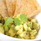 Roasted Pepper-Avocado Salsa - Habanero and Anaheim chile peppers add sizzle to a zesty salsa starring chopped avocados, onion, garlic, tomatoes, lime juice, and seasonings.