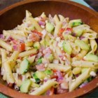 Greek Pasta Salad - Penne pasta has great company in this robust salad that is hearty enough to serve as an entree. Tomatoes, cucumbers, green peppers, sweet onion and black olives are tossed with the pasta and an herbed oil and lemon juice dressing.