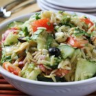 Greek Orzo Salad - Orzo pasta is tossed with artichoke hearts, cucumber, feta, tomato, olives and a zesty dressing.