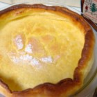 Dutch Babies II - I love to eat these! They are warm and light, yet very filling. Great on cold mornings.  This recipe is from my great grandmother. Serve with warm maple syrup and wedges of lemon.