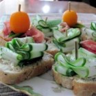 Cuke Baguette  - This is very easy! Cool cucumbers and a mild dip top fresh baguette slices. This was served at a party I attended and tasted very good.