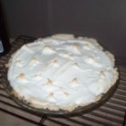 Mom's Chocolate Meringue Pie - Rich, creamy and very chocolaty, this pie 's ingredients are simmered slowly on the stove until they perfectly blend and the filling is thick and ready to pour into a pie shell. The chocolate custard pie is topped with a glossy meringue and slipped into the oven.