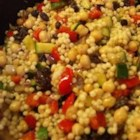 Moroccan Couscous - An array of toasted spices, vegetables, and fruits complement this beautiful couscous. This dish is great served with the Lamb Tagine and Cucumber Raita, also on this site.