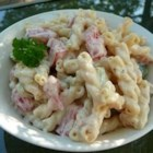 Chile Pasta Salad - Yogurt, Dijon mustard and tongue tickling jalapenos mix it up with tomatoes, onion and garlic to make a zingy sauce for a chilled pasta salad.