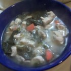Lemon Chicken Soup II - Leftover cooked chicken is simmered in chicken broth with rice, spinach and lemon juice in this easy soup.