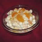 Mama's Ambrosia - A sweet concoction of mandarin oranges, fruit cocktail, coconut, marshmallows and crunchy walnuts is nestled in smooth sour cream in this favorite dessert salad.