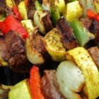 Kabobs - Grilled steak and chicken that doesn't dry out on the grill, but stays moist and flavorful. These kabobs are simple to make, and delicious to eat. Skewered meat with peppers, onions, and mushrooms in a honey teriyaki sauce.