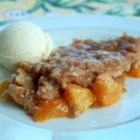 Juicy Peach Crisp - Peaches are baked with a streusel topping to make a peach crisp without oats.