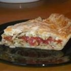 Easy Tomato Pie - This succulent, savory pie is loaded with tomatoes, Swiss cheese and cottage cheese, all accented with basil, parsley and onion flakes. You can enjoy this pie year round: use canned tomatoes and dried basil in the winter, but be sure to treat yourself to fresh in the summer!