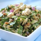 Spinach and Orzo Salad - Orzo pasta is tossed with spinach, red onion, feta cheese, pine nuts, basil, olive oil and balsamic vinegar, creating a delicious, colorful cold salad.