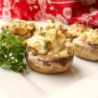 Artichoke Stuffed Mushrooms - This recipe will deliver tasty mushrooms stuffed with cheese, onion, and artichoke hearts.
