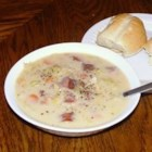 Cabbage Patch Soup - This vegetable soup recipe incorporates sauteed bacon bits and onion with cabbage and onions in a chicken broth.  Sour cream and peas are added immediately before serving.