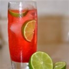 Cherry Limeade II - A thirst quenching drink with lemon-lime soda and grenadine with a wedge of lime squeezed in for good measure.