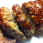 Easy Meatloaf - No-fail meatloaf calls for ground beef, onions, egg, milk, and bread. It is topped with a mix of brown sugar, mustard, and ketchup before baking.