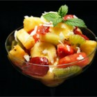 Pina Colada Fruit Salad - A nice summery fruit salad that will have you reminiscing of time spent on the beach.