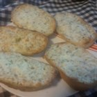 Garlic Bread Spread - It's easy to make fragrant, cheesy garlic bread seasoned with herbs to go with your Italian dinner. Fines herbs is a French seasoning mix made of tarragon, chervil, chives, and parsley; you can use Italian seasoning instead.