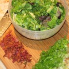 Killed Lettuce and Onion - Fresh leaf lettuce is tossed with hot bacon fat and green onions, causing the lettuce to wilt and 'killing' it. Killed or 'kilt' lettuce is a traditional Appalachian recipe often served with pinto beans and cornbread.