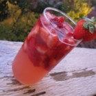 Pretty in Pink Sangria - Frozen, sliced strawberries, lemonade concentrate, and ginger ale combine for a festive punch.
