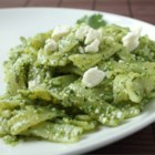 Tagliatelle with Coriander Pesto - A perfect light dish for spring combines cilantro pesto made with pine nuts and feta cheese with tagliatelli (wide fettucine) pasta. The bright green pasta dish takes only 25 minutes.