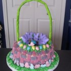 Easter Basket Cake - A two-layer cake is transformed into an Easter basket with green coconut grass filling.