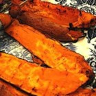 Grilled Chipotle Sweet Potatoes - Sweet potatoes aren't just for Thanksgiving. When coated in a sweet and spicy sauce and grilled until tender, they make a fabulous summer side dish.