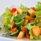 Spinach Cantaloupe Salad with Mint - Spinach is dressed up with juicy cantaloupe, red bell pepper, avocado, and fresh mint in this colorful salad.