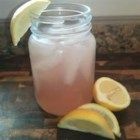 Swamp Water - This refreshing beverage has the appearance of swamp water, but the flavor and fragrance are quite pleasant! Apricot brandy and lime vodka swill together with lemonade.