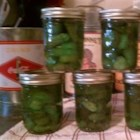 Eight-Day Icicle Pickles - You do a little something to these cucumber pickles every day for 7 days, then process and can them on Day 8. They are pickled in a large (10-quart) jar or a pickle crock.