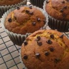Pumpkin Chip Muffins - This is a yummy muffin recipe that has become an annual tradition, especially for fall and Halloween class parties. Especially tasty when they are still warm, these pumpkin muffins are full to brimming with chocolate chips!