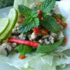 Larb - Laotian Chicken Mince - Wrap this authentic larb gai in fresh lettuce leaves to contrast the flavors of fish sauce, lime juice, and toasted rice.