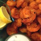 Buffalo Shrimp - Succulent shrimp twice-coated in seasoned flour and deep fried, then coated in an extremely spicy butter sauce. Perfect for those who crave the heat. For added heat, slice up some fresh cayenne or jalapeno peppers to sprinkle over the top. Serve with lemon wedges and blue cheese dressing on the side.