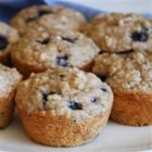 Health Nut Blueberry Muffins - Whole wheat flour, oats and wheat germ lend a hearty texture to these delicious muffins. An awesome healthy alternative to the usual blueberry muffin.