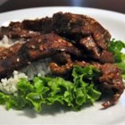 Beef Bulgogi - Marinate beef steaks in this a sweet sauce of soy, sugar, garlic, and sesame and grill.  Roll up in red leaf lettuce with rice and hot pepper paste for a real Korean-style treat.