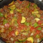 Italian Sausage and Zucchini - A simple recipe for a quick dinner. Italian sausage is browned with summer squash, zucchini and onion, then simmered with tomatoes for a satisfying meal.