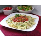 Garden Basket Pasta with Clam Sauce - A sweet saute of onion, carrot and garlic melds with the flavors of clam juice, tomatoes and bell peppers in a fragrant simmer. Stir in the clams, parsley and freshly chopped basil, and toss with hot fettuccini.