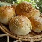 Belle's Hamburger Buns - These hamburger buns are so easy to make and turn out light and fluffy. A quick brush with an egg wash before baking gives them a beautiful golden brown color.