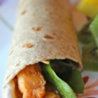 Simple Sweet and Spicy Chicken Wraps - A flour tortilla is filled with sweet, spicy chicken simmered in salsa, and rolled with a cucumber, honey, and pepper mayonnaise.