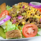 Cheeseburger Salad - A salad that tastes like a cheeseburger, with lettuce, ground beef, cheese, pickles, ketchup, mustard, and onion. Hamburger bun croutons are a fun addition.