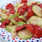 Cool Summer Cucumber and Tomato Toss - This simple summer salad is made with tomatoes and cucumbers tossed with olive oil and vinegar.