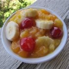 Momma Lamb's Famous Fruit Salad -  Pineapple juice is stirred into vanilla pudding mix and then the fruit  - pineapple chunks, cherries and mandarin oranges - are stirred into that. Chill and serve with sliced bananas.