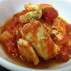 Catfish Creole - Catfish in stewed tomatoes and oregano over rice.