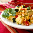 Calabacitas con Elote (Zucchini with Corn) - This mixture of zucchini, corn, tomatoes, and poblano pepper can be served as a side dish or eaten with warm tortillas as a main course.